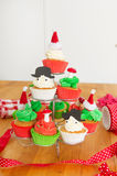 Baking Christmas cupcakes Royalty Free Stock Image