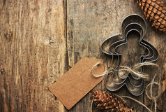 Baking Christmas gift background. Gingerbread man cookie cutter Royalty Free Stock Photo