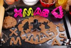 Baking christmas gingerbread cookies Stock Photo