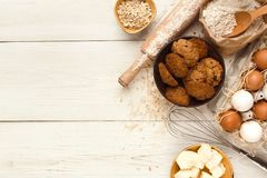 Baking classes or dough making background and mockup. Cooking ingredients for sweet oatmeal cookies background. Eggs, butter, flour, spices and kitchen utensils royalty free stock images