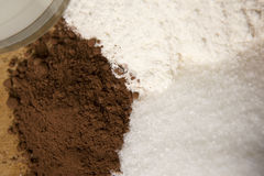 Baking with cocoa sugar flour Stock Photography