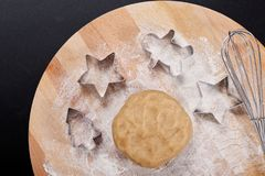 Baking concept Homemade organic Butter sugar Cookies dough on round wooden board and cookie cutter various shape Stock Photo