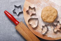 Baking concept Homemade organic Butter sugar Cookies dough on round wooden board and cookie cutter various shape Stock Image