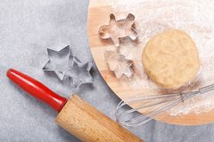 Baking concept Homemade organic Butter sugar Cookies dough on round wooden board and cookie cutter various shape Royalty Free Stock Image