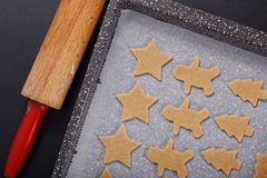 Baking concept Homemade organic Butter sugar Cookies dough on round wooden board and cookie cutter various shape Stock Photos
