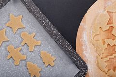 Baking concept Homemade organic Butter sugar Cookies dough on round wooden board and cookie cutter various shape Royalty Free Stock Photography