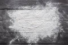 Baking concept on wood background, sprinkled flour with copy space royalty free stock images