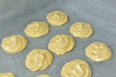 Baking cookies on a backing paper closeup. Homemade concept stock image