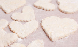 Baking cookies for valentines Royalty Free Stock Image