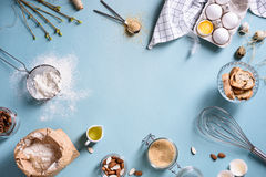 Baking or cooking background frame. Ingredients, kitchen items for baking cakes. Kitchen utensils, flour, eggs, almond, cinnamon. stock photography