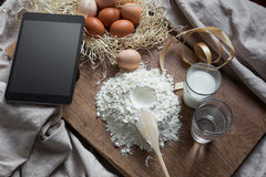 Baking and cooking with digital tablet Royalty Free Stock Photography