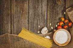 Baking or cooking ingredients top view on vintage wooden background Royalty Free Stock Images