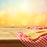 Baking and cooking utensil on wooden table. Over sunny blur background Royalty Free Stock Images