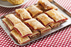 Baking crispy toast with sugar and strawbery jam royalty free stock photos