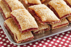 Baking crispy toast with sugar and strawbery jam stock photos
