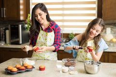 Baking cupcakes together Stock Images