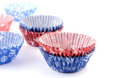 Baking cups. Empty Christmas themed baking cups on white background with selective focus Royalty Free Stock Images