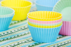 Baking cups in pastel colors Stock Images