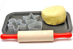Baking cups, rolling pin and pastry Royalty Free Stock Image