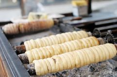 Baking of czech trdelnik Stock Photo
