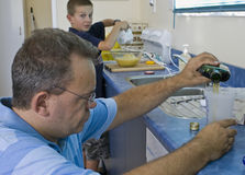 Baking with dad. Father and son cooking in kitchen stock photography