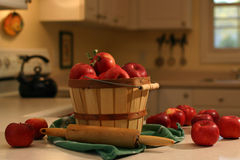 Baking day. Bushel basket of apples on a kitchen counter Royalty Free Stock Photography