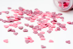 Baking decorations. Pink and purple heart shaped decorations for baking Stock Photos