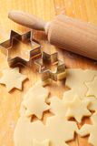 Baking detail. Arrangement of pastry, rolling pin, and cookie cutters royalty free stock images