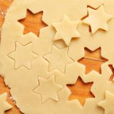 Baking detail. Detail of pastry with star shapes on wooden board stock image