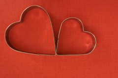Baking dish in heart shape. Two red Stock Images