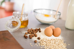 Baking dough ingredients, honey, eggs, flour Royalty Free Stock Photography