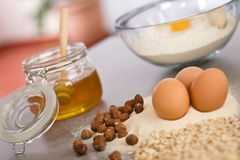 Baking dough ingredients, honey, eggs, flour Royalty Free Stock Photos