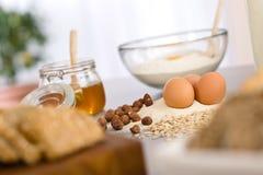 Baking dough ingredients, honey, eggs, flour Royalty Free Stock Photo