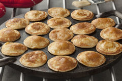 Baking Dutch mini pancakes called poffertjes Stock Images