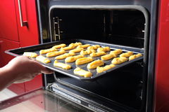 Baking Eclair Cookie in the Oven Royalty Free Stock Image