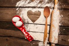 Baking, eggs, flour, plunger in rural kitchen  on vintage wood table Royalty Free Stock Image