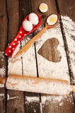 Baking, eggs, flour, plunger in rural kitchen  on vintage wood table Royalty Free Stock Images