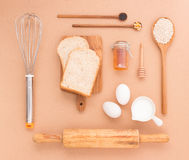 Baking Equipment make Bread wheat grains and cereals on wooden b Stock Photo