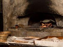 Baking flatbread in outdoor oven, Nazareth Village Royalty Free Stock Photo