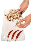 Baking food - woman cuts mushroom Royalty Free Stock Image