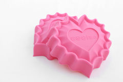 Baking form. Heart shaped pink   silicone form Stock Image