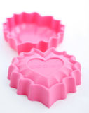Baking form. Heart shaped pink   silicone form Royalty Free Stock Photography