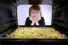 Baking french fries Royalty Free Stock Photography