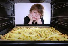 Baking french fries Royalty Free Stock Images