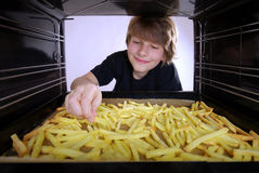 Baking french fries Stock Photography