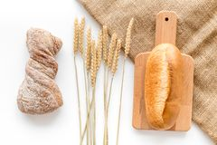 Baking fresh wheaten bread on bakery work table background top view Stock Photography