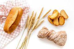 Baking fresh wheaten bread on bakery work table background top view Stock Photos