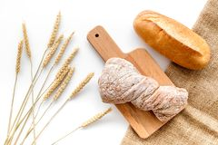 Baking fresh wheaten bread on bakery work table background top view Royalty Free Stock Images