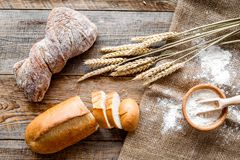 Baking fresh wheaten bread on bakery work table background top view Stock Photos