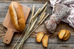 Baking fresh wheaten bread on bakery work table background top view Royalty Free Stock Photos